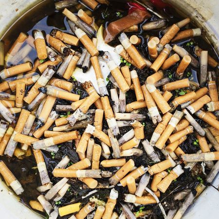 Wet cigarette ends in a bucket Cigarette  Ends Butts Wet Smoking Habit Addiction Trash Mess Ugly