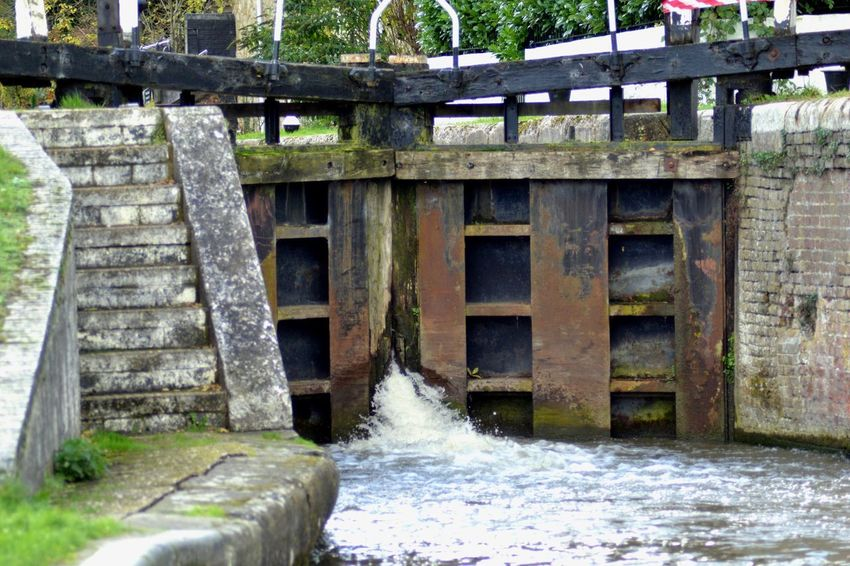 Canal lock gate Canal Lock Canal Life Water Bridge - Man Made Structure Architecture Built Structure Connection Day EyeEmNewHere River Outdoors Motion No People