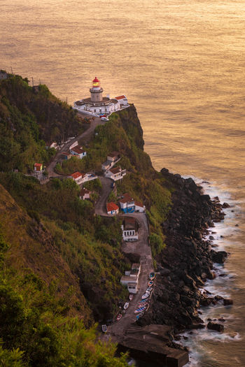 View of farol do arnel, the oldest lighthouse on sao miguel island, azores  at sunrise