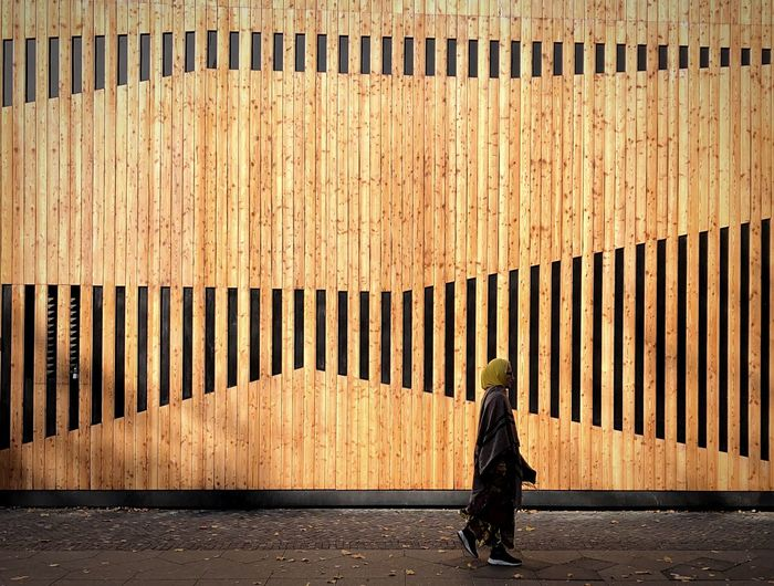 Wood - Material One Person Real People Day Architecture Women Adult Full Length Built Structure Wall - Building Feature Sunlight
