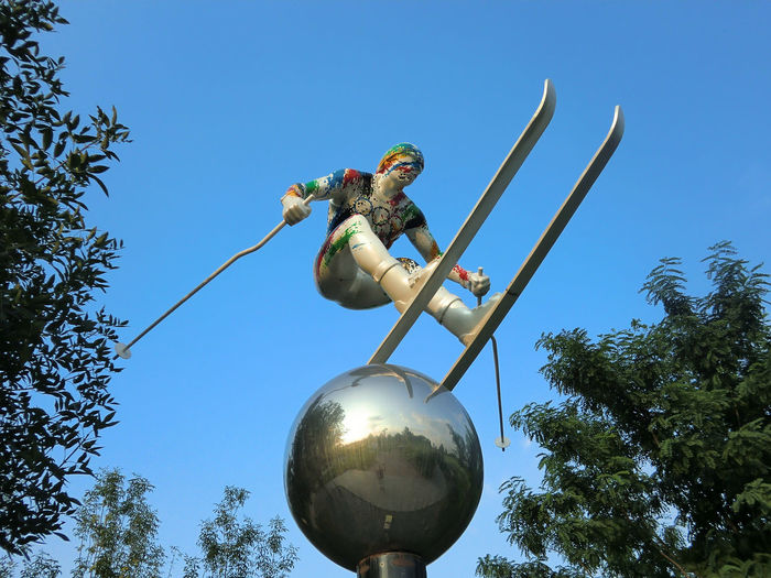 Skiing Statue Blue Clear Sky Day Low Angle View One Person Outdoors People Real People Sky Tree
