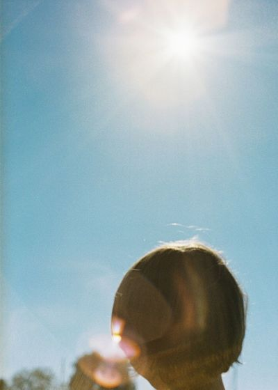 Portrait of woman against sky on sunny day
