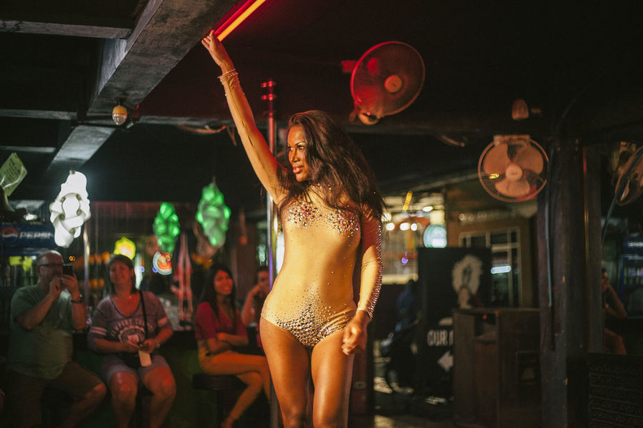 Local Part Of Phuket Prostitute Thai Thailand Woman Adult Bar Cheerful Dancing Enjoyment Fun Happiness Illuminated Indoors  Ladyboy Leisure Activity Lifestyles Night Night Time Nightclub Nightlife One Person People Performance Real People Standing Women Young Adult Young Women