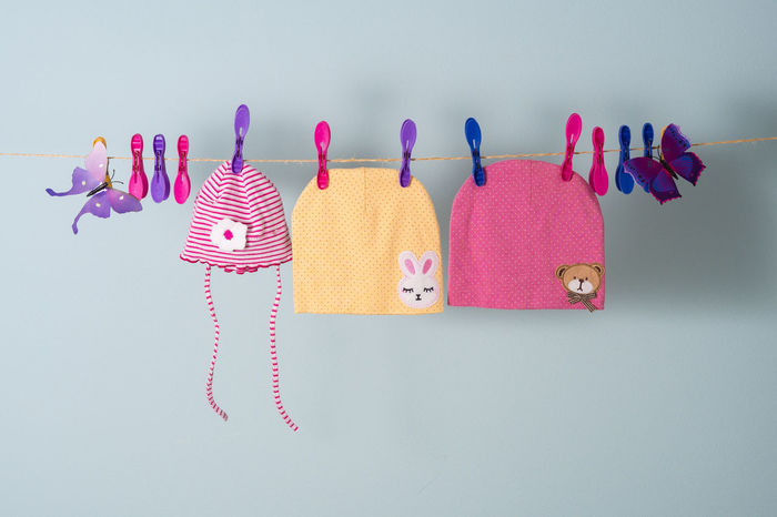 Little girl caps on the clothline Baby Background Cap Child Clean Clothes Clothespin Clothing Clothline Cute Drying Drying Clothes Girl Hanging Hat Large Group Of Objects No People Pink Pink Color Rope Small Still Life Toddler  Wash