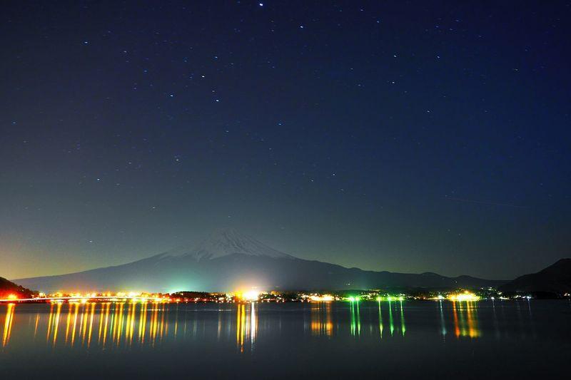 Illuminated Town By Mount Fuji At Night