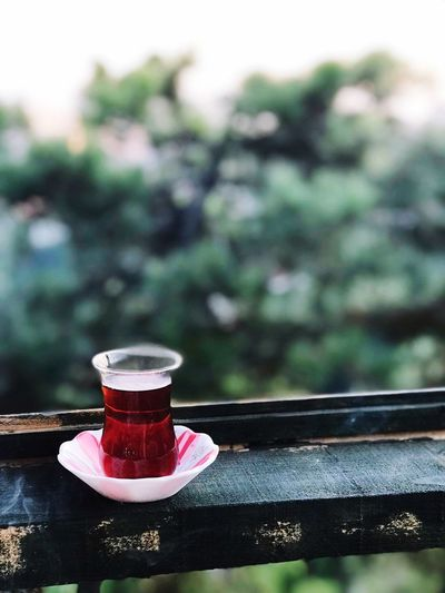 Herbal tea in glass on table