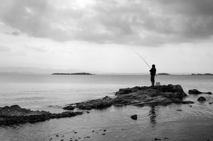 Clouds Coast Fisherman Fishing Islands Landscape Rays Of Light Rays Of Light On Sea Rockabilly Sea Sea And Sky Silhouette Silhouettes Sunlight Water My Favourite Place