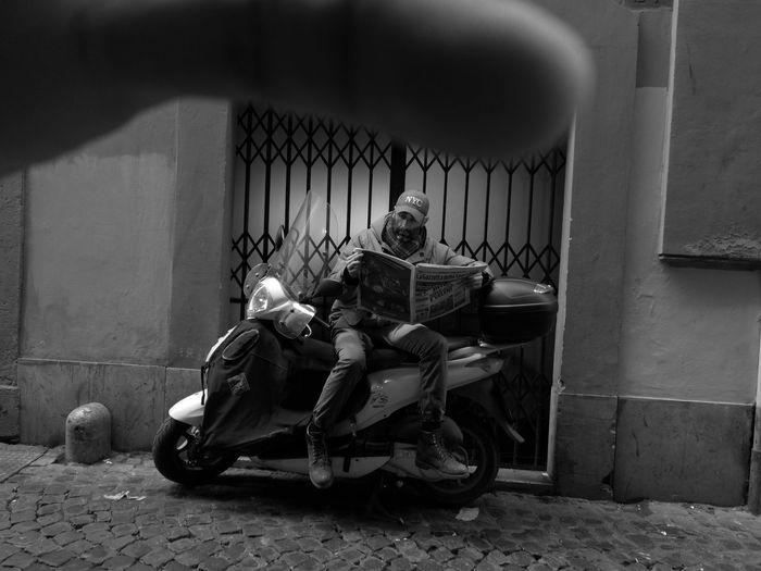 People sitting on motor scooter on street
