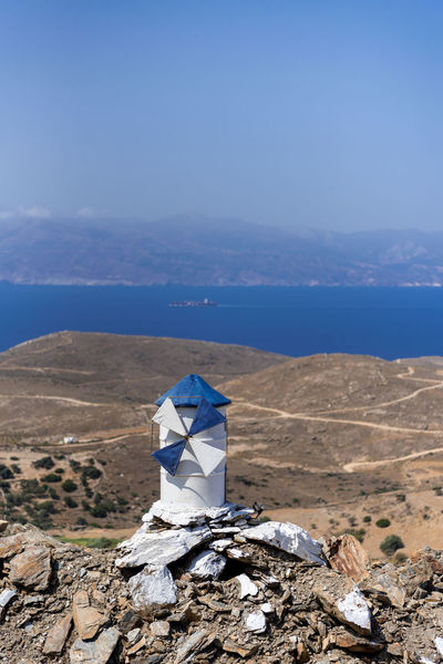 Playing with the wind Andros Island GREECE ♥♥ Greece Photos Windmill Andros Beauty In Nature Blue Blue And White Blue Sky Day Greece High Angle View Landscape Nature No People Outdoors Sea Sea And Sky Sky Tranquil Scene Water Windmill Of The Day