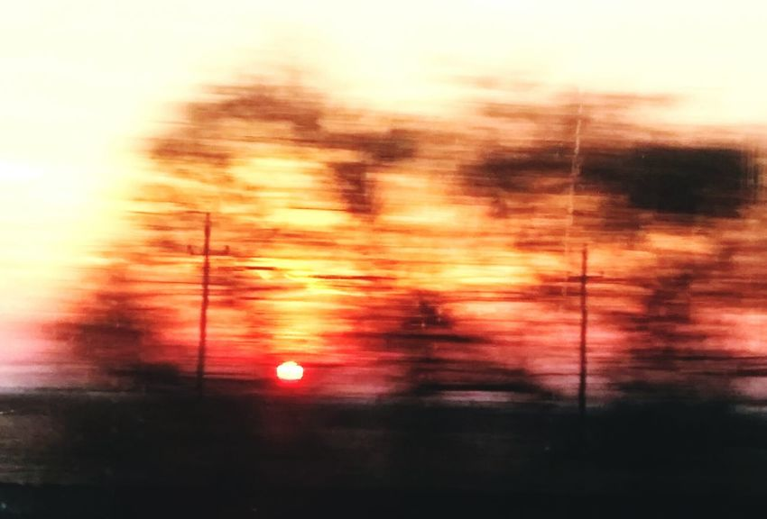 Sunset Sky Orange Color Dusk No People Blurred Motion Nature Dramatic Sky Motion Tree Outdoors Cloud - Sky Beauty In Nature Day