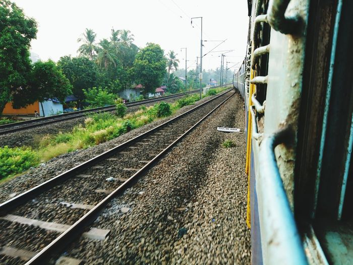 Railway tracks by train against sky
