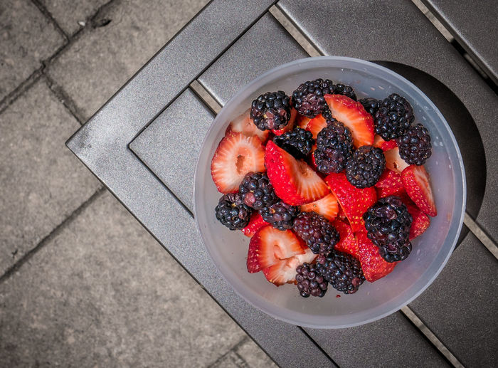 High angle view of fresh berries in plate on table