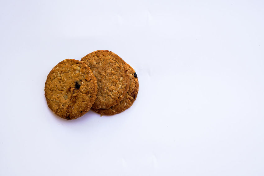Baked Chocolate Chip Cookie Close-up Cookie Dessert Food Food And Drink Freshness Indulgence Muffin No People Raisin Ready-to-eat Snack Studio Shot Sweet Food Unhealthy Eating White Background