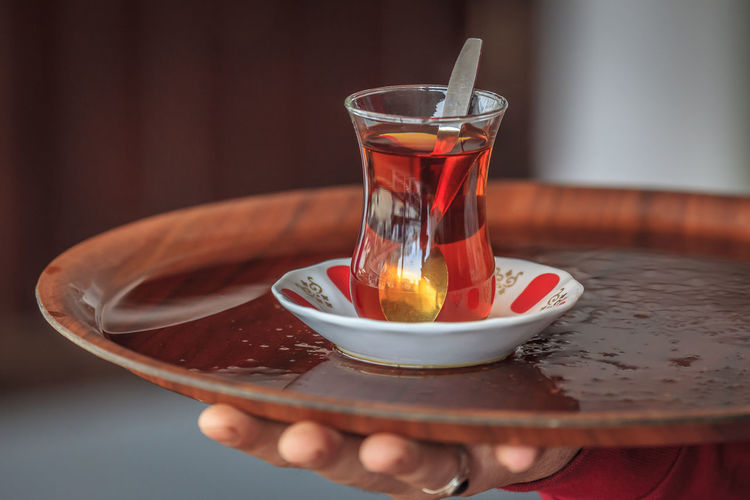 Offered a refreshing cup of tea while in Istanbul Refreshment Food And Drink Glass Drink Human Hand Tea Hand Drinking Glass Tea - Hot Drink Hot Drink Close-up Indoors  Human Body Part Household Equipment Selective Focus Table Holding One Person Freshness Bowl Crockery Tea Cup Finger Tea Turkey