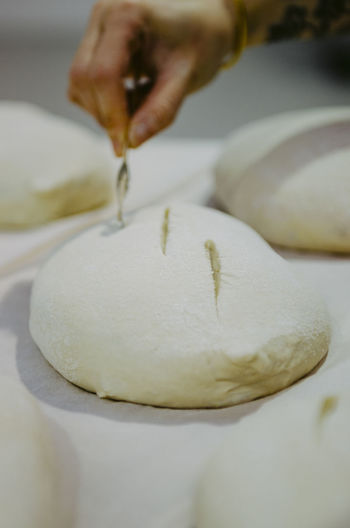 Human Hand Hand Human Body Part Food One Person Food And Drink Preparation  Freshness Indoors  Skill  Close-up Dough Holding Occupation Preparing Food Sweet Food Making Art And Craft Selective Focus Chef Finger