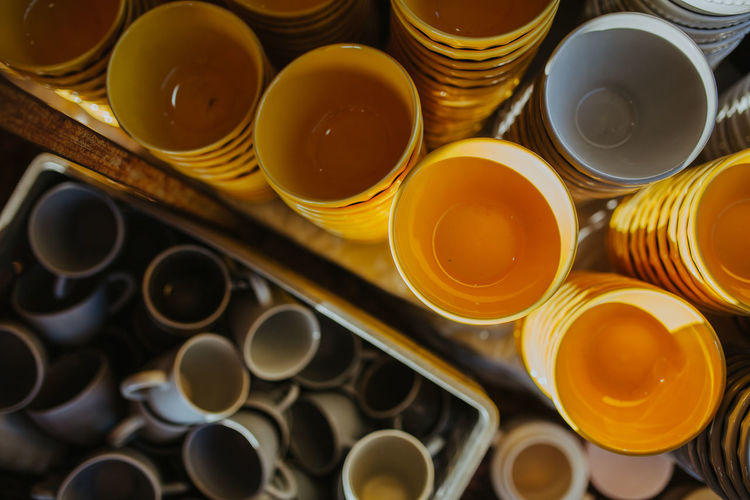High angle view of various pottery cups