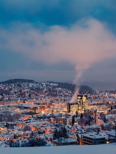High angle view of illuminated city against sky during winter