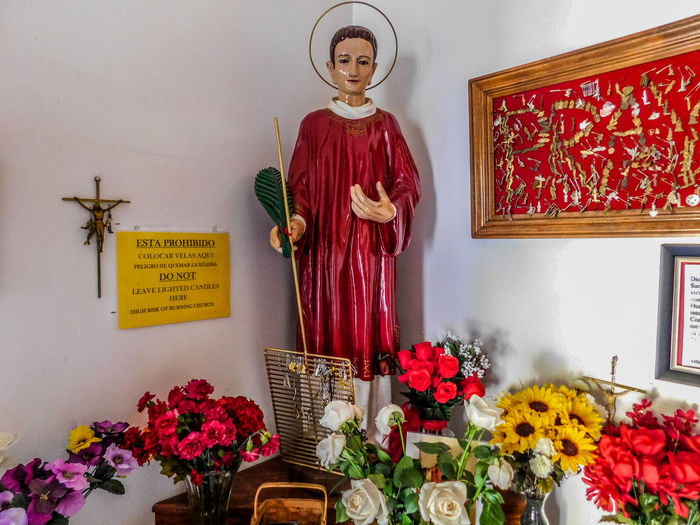 San Lorenzo, Catholic Church, Clint Texas. Saint Lorenzo is the Patron Saint of Cooks Flower Flowering Plant Plant Indoors  Arrangement Table Representation Human Representation Vase Freshness Spirituality No People Religion Flower Arrangement Picture Frame Text Nature Belief Red Place Of Worship Flower Head Bouquet