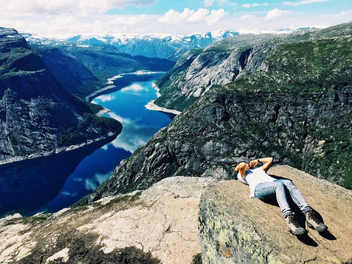 Woman resting on mountain top