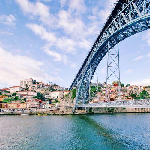 Dom Luis I Bridge Over River Against Sky