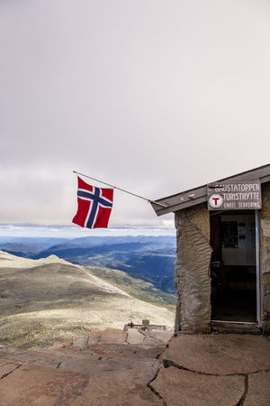 Norge Norway The Week On EyeEm Architecture Beauty In Nature Building Exterior Built Structure Day Flag Flags Mountain Mountain Top Nature No People Norwegian Flag Outdoors Patriotism Sky