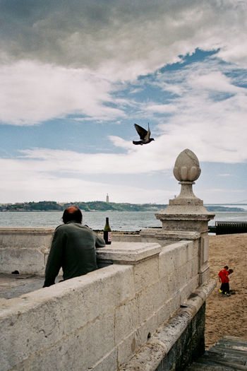 #urbanana: The Urban Playground 35mm Film Analogue Photography Portugal Travel Architecture Bird Built Structure Cloud - Sky Day Lisbon Looking At View Outdoors Real People Sea Sky Travel Destinations Water