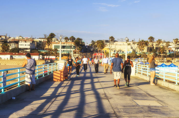 Pier at Manhattan Beach in LA Architecture Blue Building Exterior Built Structure Casual Clothing City City Life Day La Large Group Of People LAX Lifestyles Manhattan Manhattenbeach Men Outdoors Person Residential District Shadow Sky Sunlight Sunny The Way Forward Town USA