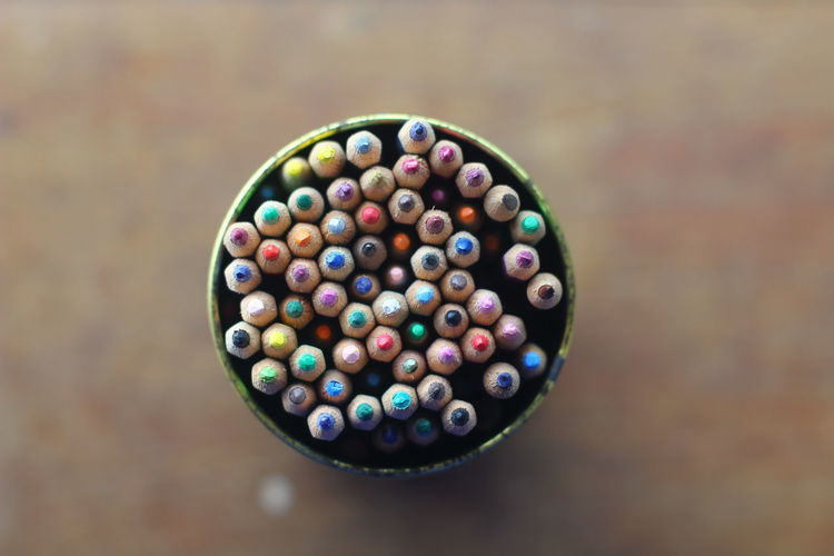 High angle view of multi colored pencils in container