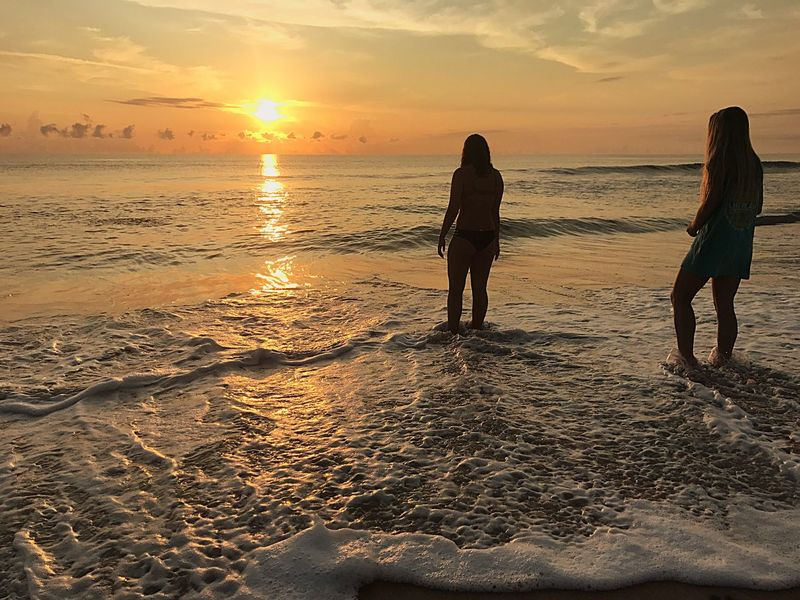 Beachy people Beach Sea Sand Two People Nature Beauty In Nature Pier Sunrise Horizon Over Water Silhouette Labor Day Connected By Travel