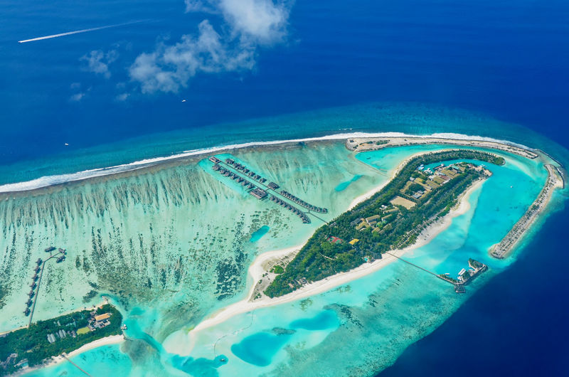 Islands surrounded by lagoon and barrier reef Aerial View Blue Water Island Lagoon Maldives Overwater Bungalow Reef Resort Tourist Destination Turqoise Water Waterscape The Essence Of Summer Landscapes Feel The Journey Color Palette