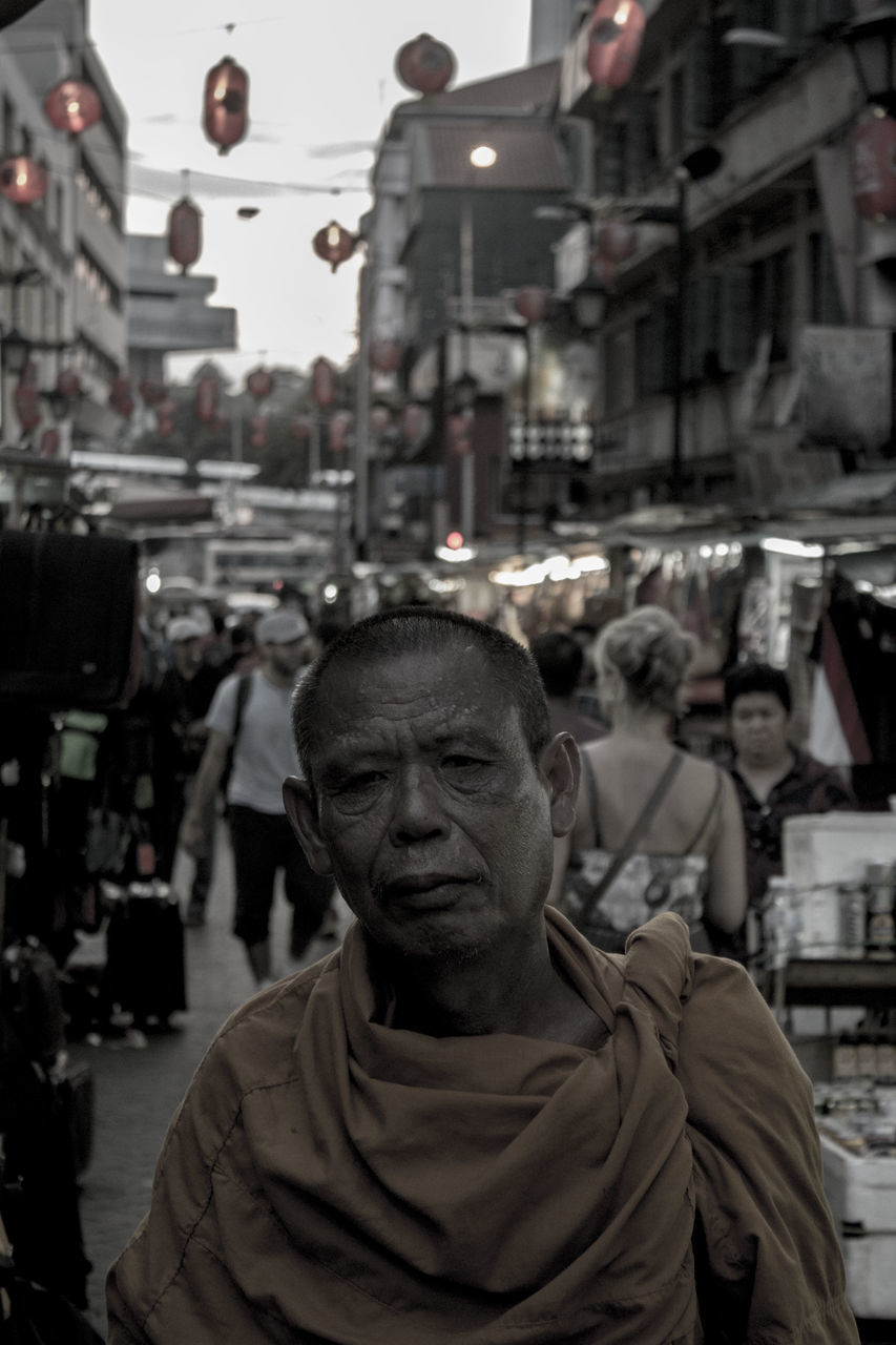 real people, built structure, architecture, building exterior, street, incidental people, city, senior adult, men, senior men, market, outdoors, large group of people, day, crowd, adult, people