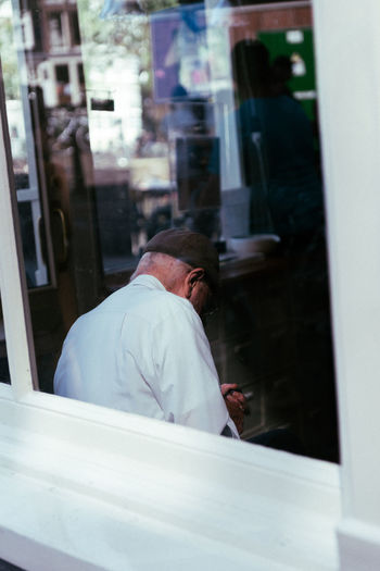 Man sleeping by window