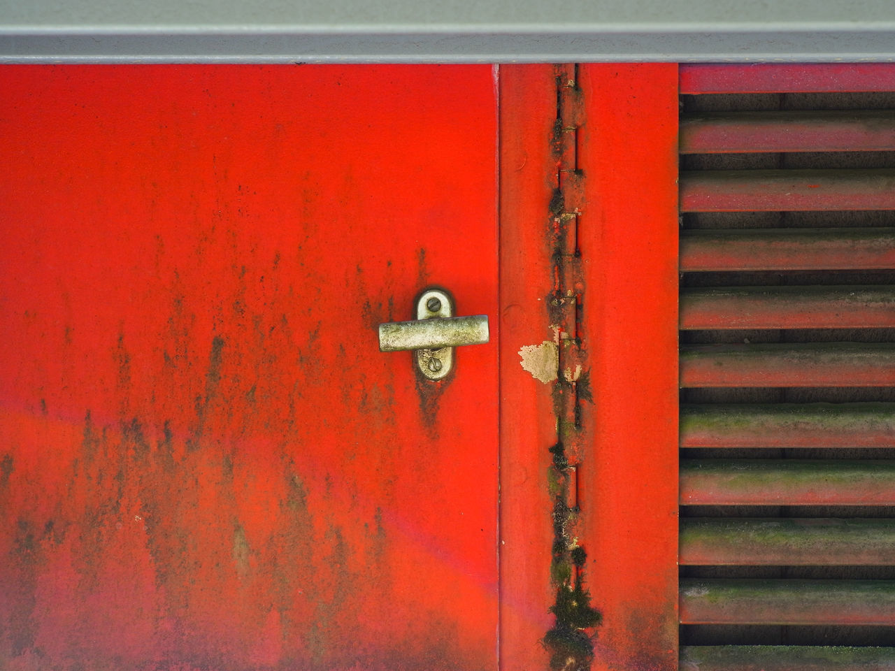 FULL FRAME SHOT OF RED DOOR WITH METAL GATE