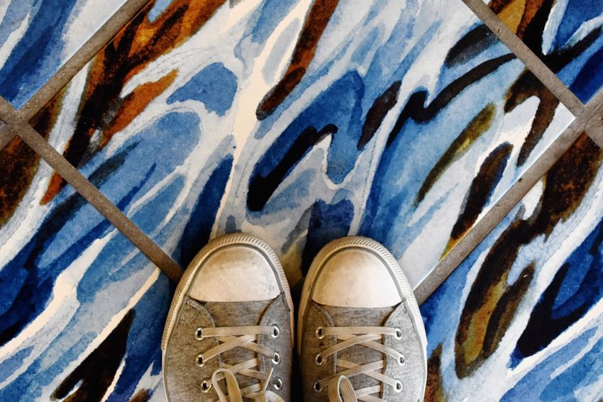 Simple shoes, patterned background Tiled Floor Shoe Low Section High Angle View Day Human Leg One Person Unrecognizable Person Directly Above Personal Perspective Standing Close-up Blue Pattern