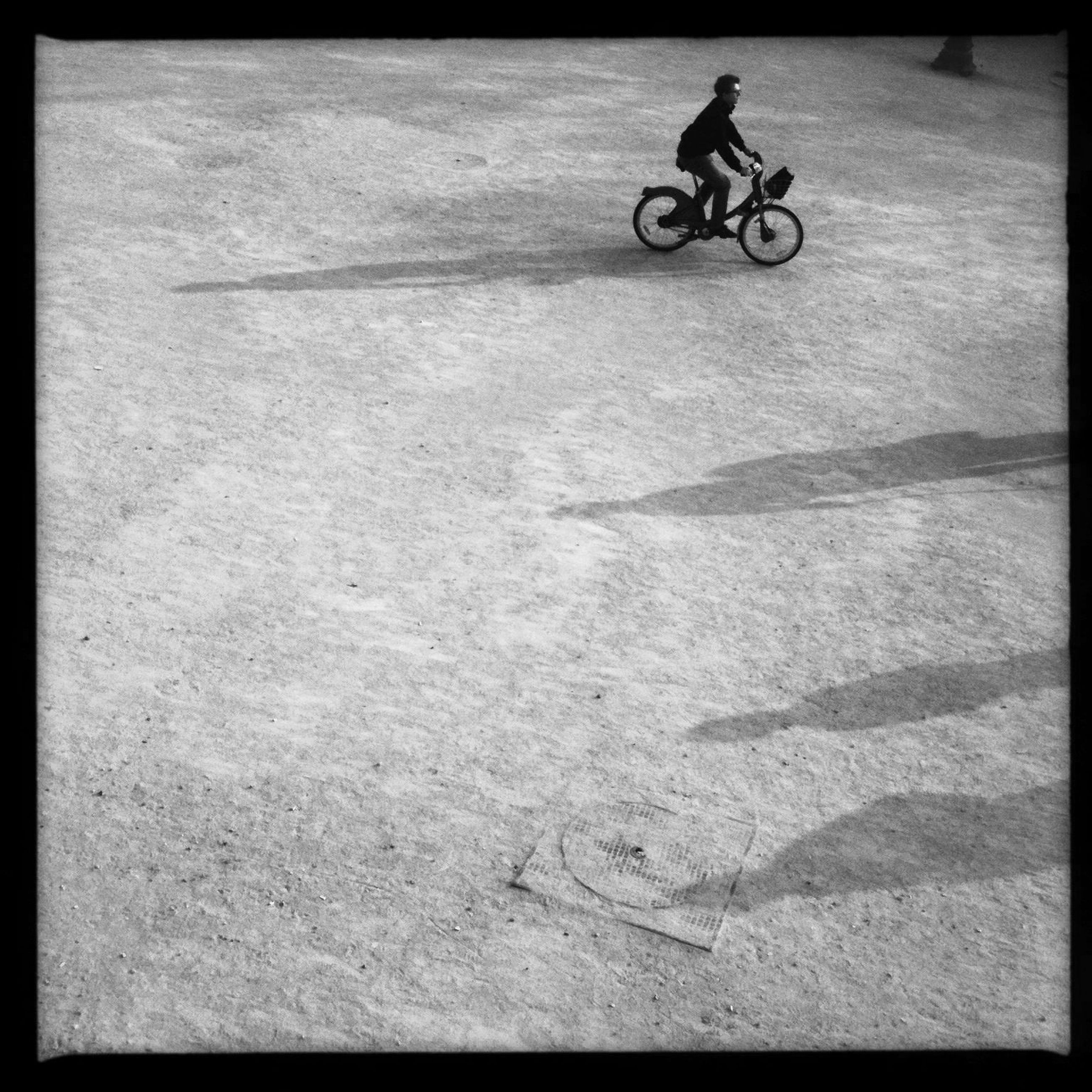bicycle, lifestyles, transportation, leisure activity, low section, men, mode of transport, riding, land vehicle, shadow, street, cycling, on the move, sunlight, full length, sport, walking, person