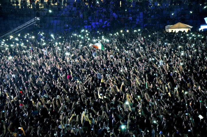 Crowd of people partying at a music festival Concert Concert Photography Crowd Crowded Dance Event Festival Fun Hands Light Lights Musician Nightlife Party Partying People Phone Raised Romania Show Stadium, Stagephotography Teenager Untold Young