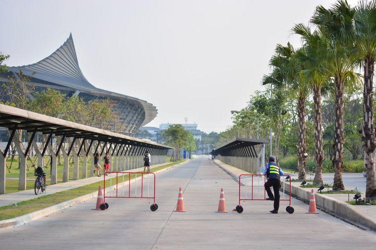 Barricades on street by stadium against sky