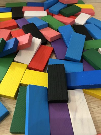 High angle view of multi colored block shapes on table