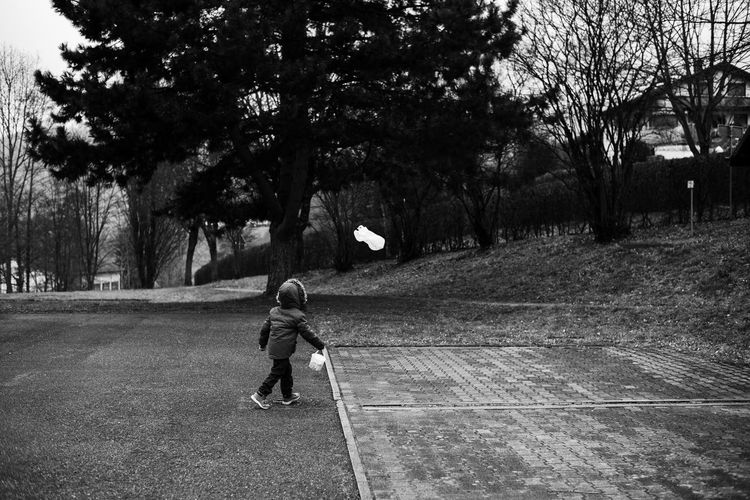 Black & White Black And White Blackandwhite Child Childhood Dark Darkness And Light Day Full Length Lifestyles One Person Outdoors People Plastic Plastic Bag Playing Real People Running Tree