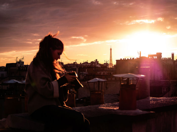 Paris Sunset with Anna ✌😉Welcome To Black City One Person Sunset Cityscape Outdoors Urban Skyline Style Expatriatesmagazine EyeEmNewHere Paris Shadows & Lights Olympus Rooftop Paris Roofs Sky Sky And Clouds Sunrise Sunlight Pink Darkness And Light Shadow Eiffel Tower Eiffel Orange Sky The Secret Spaces Live For The Story Second Acts Colour Your Horizn The Great Outdoors - 2018 EyeEm Awards HUAWEI Photo Award: After Dark Summer In The City