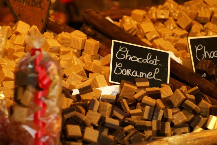 Close-Up Of Chocolate Caramels At Store For Sale