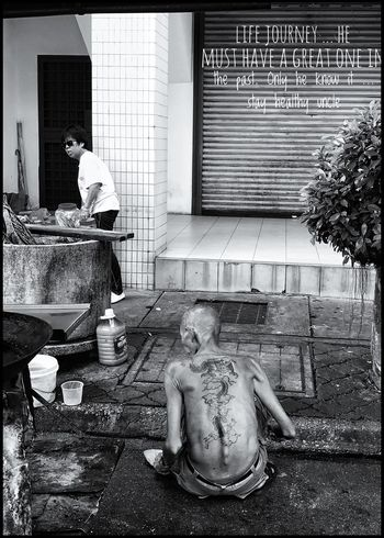 His Life Men Only Men Working Building Exterior Adult Built Structure Architecture One Man Only Washing Hygiene Day Adults Only Cleaning Outdoors People Occupation One Person City Butcher tattooed