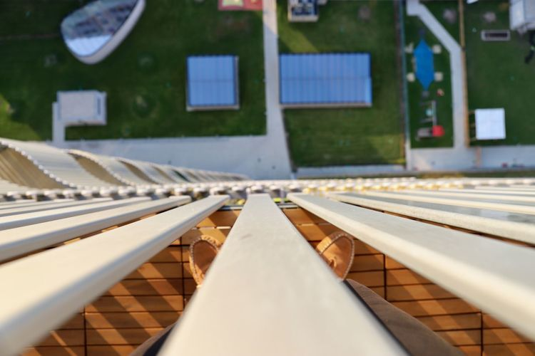 Balcony View Grass Stripes Architecture Balcony Bird Perspective Building Exterior Built Structure Close-up Day Feet From Up Glass Light And Shadow No People Outdoors Playground Shadow Shoes Stripes Pattern Sunny Day Up View Way Wood - Material Yard (null) Rethink Things Colour Your Horizn Go Higher