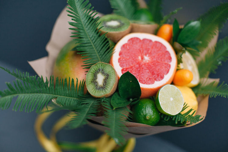 Edible fruit bouquet Mango Bouquet Celebrate Citrus Fruit Close-up Creative Day Design Food Food And Drink Freshness Fruit Fruit Bouquet Gift Grapefruit Green Color Healthy Eating Indoors  Kiwi Leaf Lime Mint Leaf - Culinary No People Present