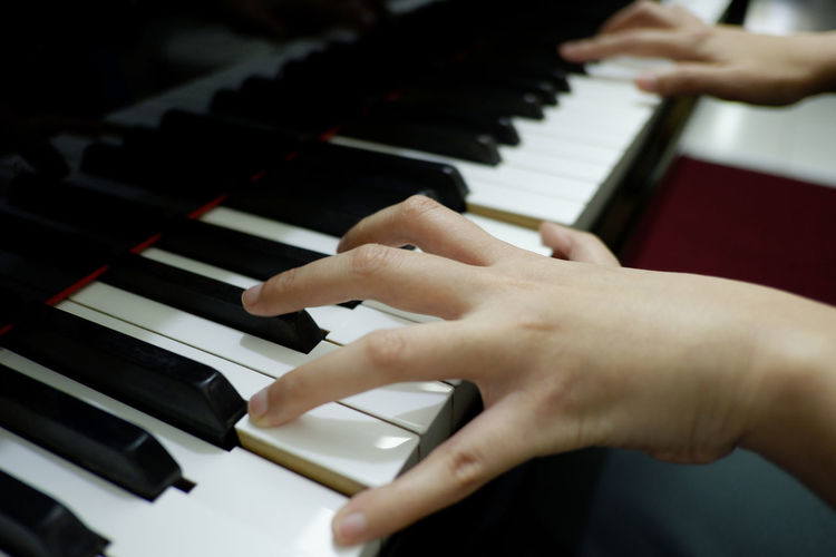 close-up female hand playing grand piano Musical Equipment Musical Instrument Piano Music Hand Playing Piano Key Skill  Indoors  Pianist Keyboard Arts Culture And Entertainment Finger Musician Keyboard Instrument Leisure Activity Piano Grand Music Practicing Performing Rythm Melody Note Classical