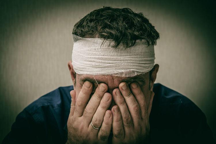 Close-up of sad injured man
