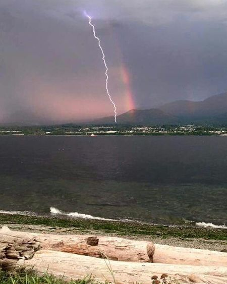 Check This Out a simultaneous Rainbow and Lightning Bolt as seen looking towards Port Angeles Washington from Ediz Hook . Lightning And Thunder Lightning Strikes Summer Storm Wild Weather Taking Photos Eye4photography  Lucky Shot Point And Shoot EyeEm Best Shots Beach Ocean Water Shoreline EyeEm Gallery Eyeem Weather Eyeem Weather Shots No Edits No Filters No Filters Or Effects Fine Art Photography Showcase July