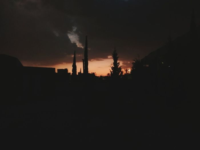 I look at you on the horizon And I do not stop listening The rhythm of the drums that Bring your black presence Dark Clouds Sunset Dark Sky Darksky Tree Factory Industry Smoke Stack Silhouette Social Issues Business Finance And Industry Dark Sky Lightning
