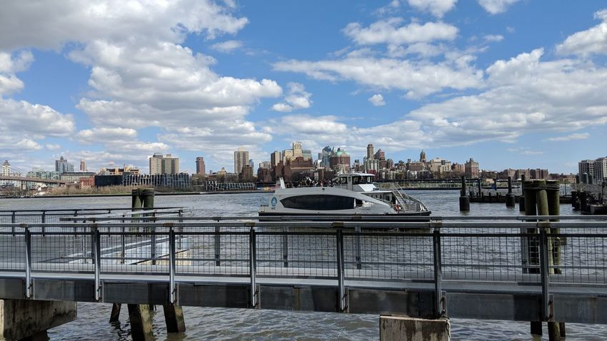 Pier 15 in New York City, NY Ferry Boat Pier 15 New York City New York Boats Beautiful Sky Clouds Buildings Skyline Travel Travel Photography Good Times Pixelxl2 Water Waterfront Boat
