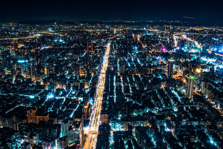 Aerial view of illuminated taipei cityscape against sky at night